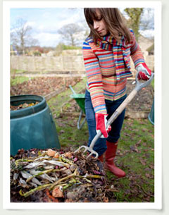 woman turning compost